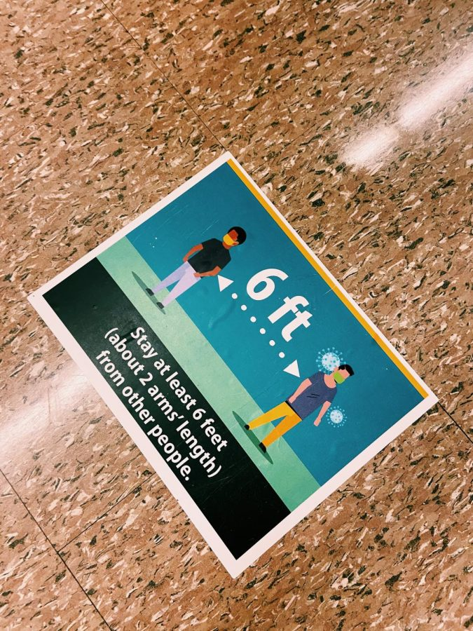 This sign is taped on the floors of the hallways at Norwalk High to remind students and staff to remain six feet apart.