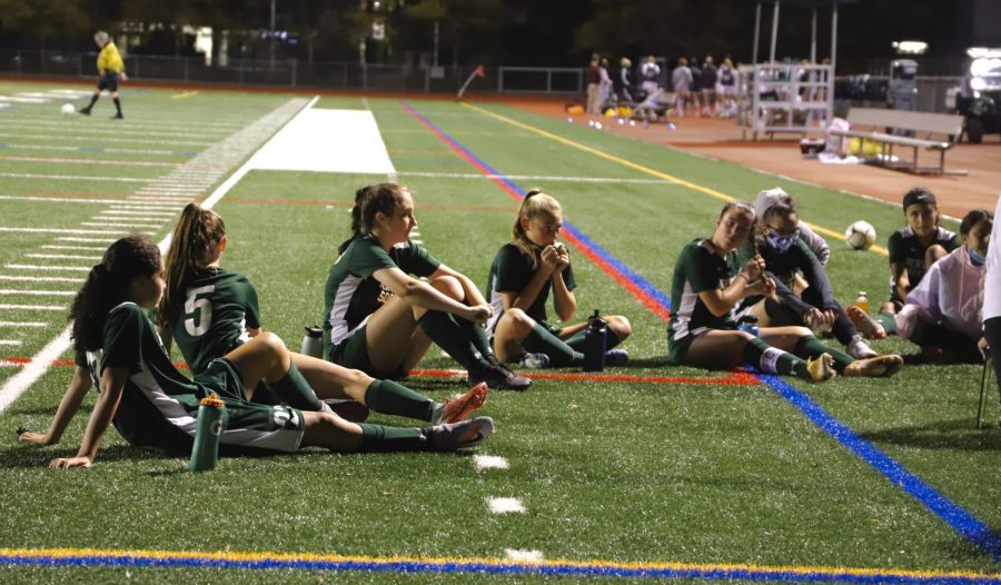 Girls soccer reviewing their plays at half time