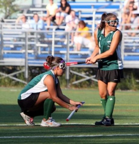 Kristy Mastropietro (right) accompanied by teammate  and twin sister Stacey during a penalty corner.